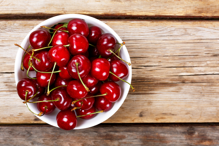 Cherry on a wooden background. View from above