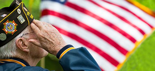 veteran salutes before flag