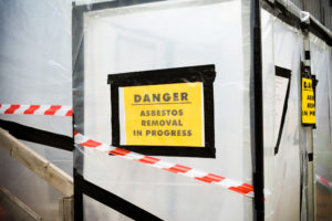 A plastic covered entrance to building undergoing an asbestos removal process.