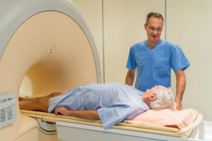 Radiologist talking to a senior patient at MRI scan.